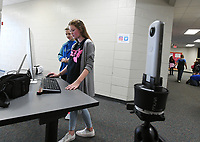 NWA Democrat-Gazette/J.T. WAMPLER Brayden Hamilton (left) and Alyssa Wilson set up their Back to the Past project Tuesday Oct. 10, 2017 at Sonora Middle School.