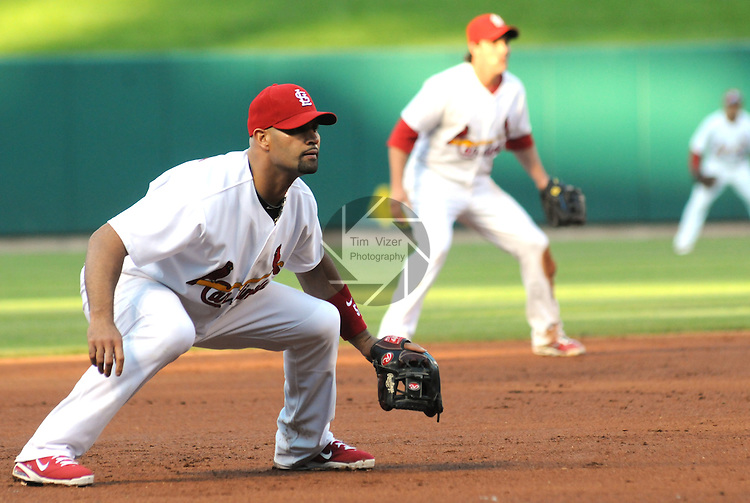 16 May 2011                              St. Louis Cardinals' Albert Pujols (5) plays third base against the Phillies.  At right is St. Louis Cardinals shortstop Ryan Theriot (3).  The St. Louis Cardinals defeated the Philadelphia Phillies 3-1 on Monday May 16, 2011 in the first game of a two-game series at Busch Stadium in downtown St. Louis.