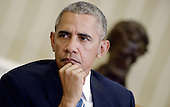 United States President Barack Obama looks on during the release of the Cancer Moonshot Report in the Oval Office of the White House on October 17, 2016 in Washington, DC. <br /> Credit: Olivier Douliery / Pool via CNP
