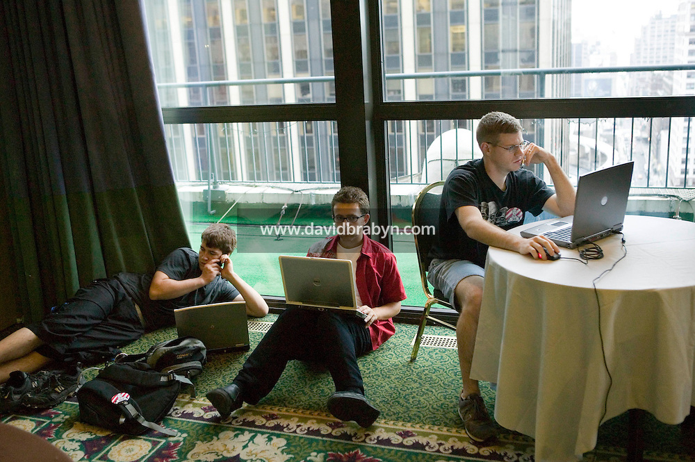 Attendees of the 6th edition of HOPE, an annual hackers' convention, spend time on their laptops, July 22nd 2006, New York City, USA.