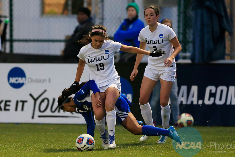 KANSAS CITY, MO - DECEMBER 03:  Jayma Martin (12) of Grand Valley State University and Taylor Hallquist (19) of Western Washington University battle for the ball during the Division II Women's Soccer Championship held at Children's Mercy Victory Field at Swope Soccer Village on December 03, 2016 in Kansas City, Missouri. Western Washington University beat Grand Valley State University 3-2 to win the national title.  (Photo by Jack Dempsey/NCAA Photos via Getty Images)