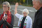 The Rev. Dr. Lyda Pierce leads prayer outside the Federal Detention Center in Seatac, Washington, during a June 24 prayer vigil in support of immigrant parents inside the prison who've been separated from their children. Pierce is coordinator for Hispanic and Latino ministries of the Pacific Northwest Conference of The United Methodist Church.
