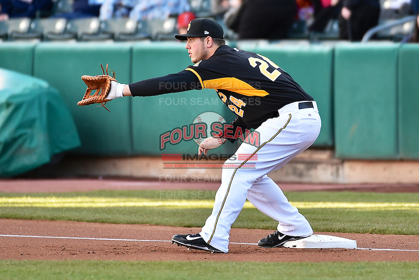 C.J. Cron (24) of the Salt Lake Bees in action against the Sacramento River Cats at Smith's Ballpark on April 5, 2014 in Salt Lake City, Utah.  (Stephen Smith/Four Seam Images)