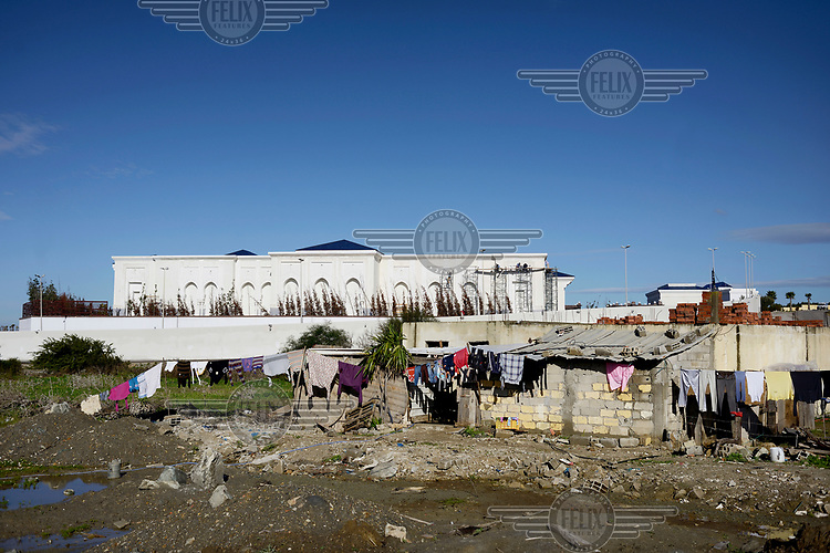Clothes drying outside a shack near the huge palace that the Saudis are building on the Tangier's coast.