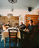 GREECE, Patmos, Skala, Dodecanese Island, taverna owner and musician Yannis Kaneli and friends play music at his restaurant, Taverna Tzivaeri