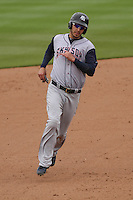 Colorado Springs Sky Sox first baseman Matt Clark (23) rounds the bases during a Pacific Coast League game against the Iowa Cubs on May 11th, 2015 at Principal Park in Des Moines, Iowa.  Colorado Springs defeated Iowa 13-7.  (Brad Krause/Four Seam Images)