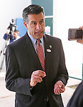 Nevada Gov. Brian Sandoval answers media questions after voting in Reno, Nev., on Tuesday, Nov. 4, 2014. Sandoval is expected to cruise to re-election over a little-known Democrat. (AP Photo/Cathleen Allison)
