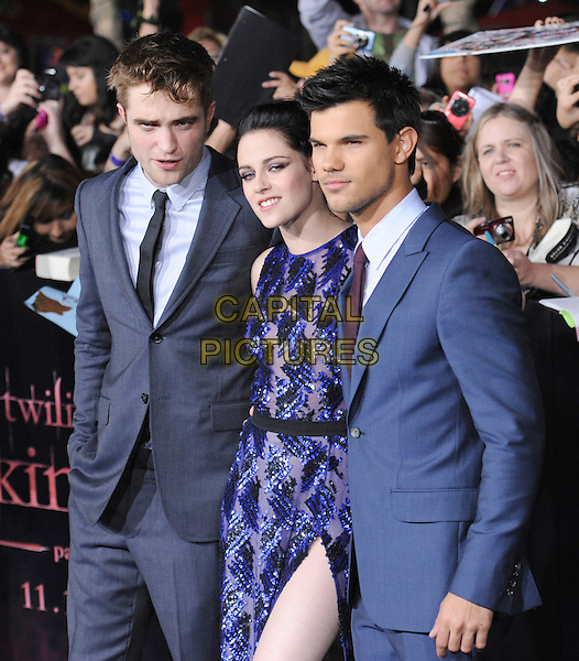 Robert Pattinson, Kristen Stewart & Taylor Lautner .The Los Angeles premiere of 'The Twilight Saga Breaking Dawn Part 1' at Nokia Theatre at L.A. Live in Los Angeles, California, USA..November 14th, 2011.half length rob grey gray suit purple black sleeveless dress slit split beads beaded couple blue side  sequins sequined .CAP/RKE/DVS.©DVS/RockinExposures/Capital Pictures.