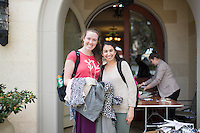 Occidental College students look through clothes donated by alumni at the Dress For Success event, March 27, 2014 in the Samuelson Alumni Center, hosted by the Career Development Center.<br />