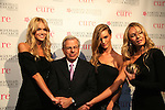 Victoria's Secret Angels - Candace Swanepoel, Rosie Huntington-Whitley and Lindsay Ellingson at the 12th Annual Collaborating For A Cure - a Dinner & Auction on November 18, 2009 to benefit the Samuel Waxman Cancer Research Foundation at the Park Avenue Armory, New York City, NY. (Photo by Sue Coflin/Max Photos)