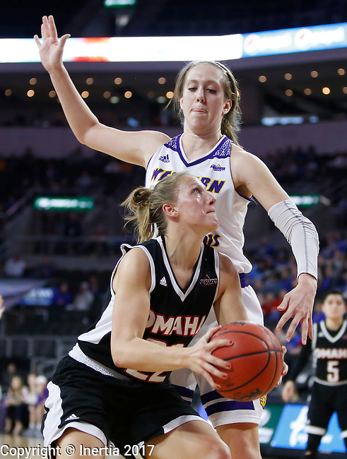 SIOUX FALLS, SD: MARCH 6: Mikaela Shaw #22 of Omaha drives against Olivia Braun  of Western Illinois during the Summit League Basketball Championship on March 6, 2017 at the Denny Sanford Premier Center in Sioux Falls, SD. (Photo by Dick Carlson/Inertia)