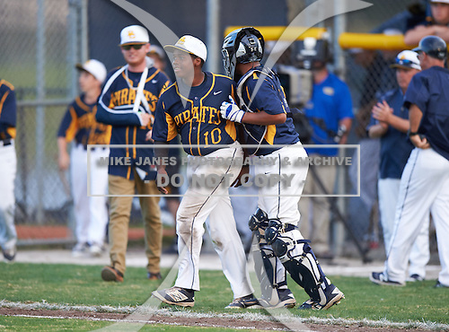 Boca Ciega Pirates Darius Blasingane (10) and catcher Ivan Rodriguez (12) celebrate after a game against the Lakeland Spartans at Boca Ciega High School on March 2, 2016 in St. Petersburg, Florida.  (Copyright Mike Janes Photography)