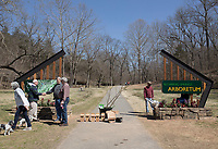 NWA Democrat-Gazette/CHARLIE KAIJO Attendees gather at the entry way of the new Blowing Springs Arboretum during an Arbor Day celebration, Monday, March 18, 2019 at Blowing Springs Park in Bella Vista. <br />