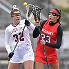 Deanna Weisenburger #32 of Garden City, left, and Sofia Afkham #23 of Syosset battle for control of a faceoff during a Nassau County varsity girls lacrosse game at Garden City High School on Saturday, April 1, 2017. Garden City won by a score of 13-9. (Note to editor: Game was shot in place of assigned Farmingdale-North Shore matchup, which I learned was canceled upon arriving at Farmingdale HS)