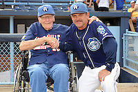 Asheville Tourists manager Joe Mikulik #20 poses for a picture with former Tourists manager Ray Hathaway on Ray Hathaway night before a game against the Rome Braves at McCormick Field on August 20, 2011 in Asheville, North Carolina. Rome won the game 10-9.   (Tony Farlow/Four Seam Images)