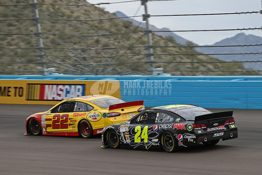 Mar. 3, 2013; Avondale, AZ, USA; NASCAR Sprint Cup Series driver Joey Logano (22) leads Jeff Gordon during the Subway Fresh Fit 500 at Phoenix International Raceway. Mandatory Credit: Mark J. Rebilas-