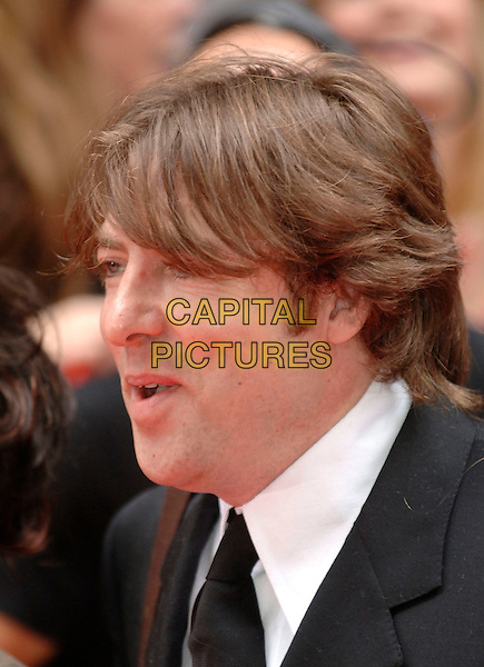 JONATHAN ROSS.Arrivals at the British Academy Television Awards, (BAFTA's) held at Grosvenor House Hotel, London, .England, May 7th 2006..bafta baftas portrait headshot funny face mouth .Ref: PL.www.capitalpictures.com.sales@capitalpictures.com.©Phil Loftus/Capital Pictures