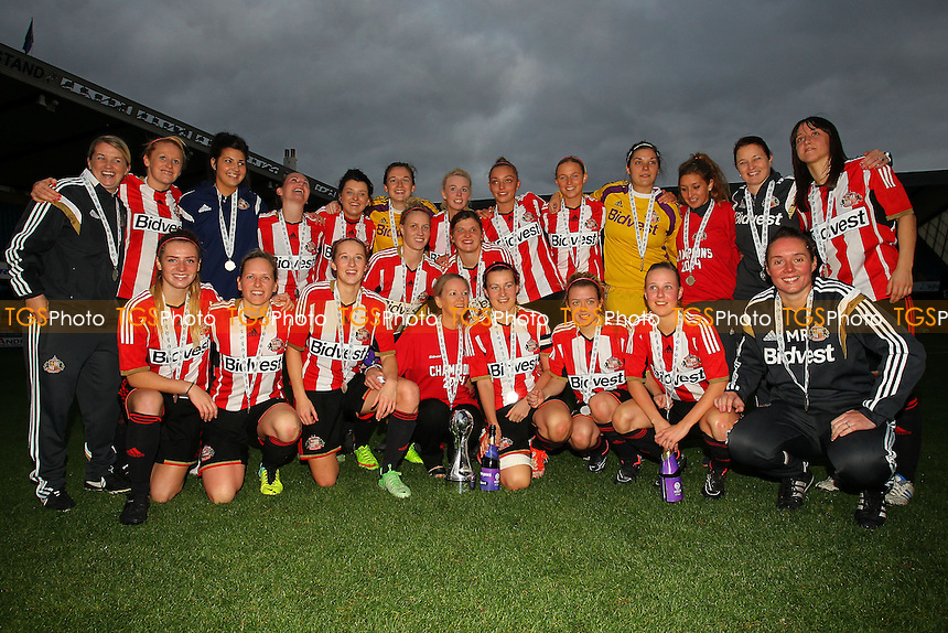 Sunderland players celebrate winning the FAWSL2 title - Millwall Lionesses vs Sunderland AFC Ladies - FA Womens Super League Football at Milwall FC, the New Den, London - 26/10/14 - MANDATORY CREDIT: Gavin Ellis/TGSPHOTO - Self billing applies where appropriate - contact@tgsphoto.co.uk - NO UNPAID USE