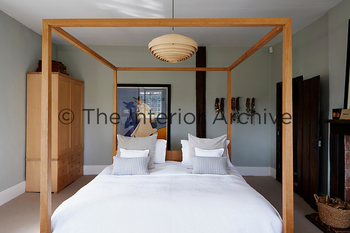 A large four-poster made by Mark Tuckey sits centre-stage in this bedroom.
