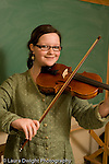 Middle School grade 8 music education portrait of girl holding her violin vertical