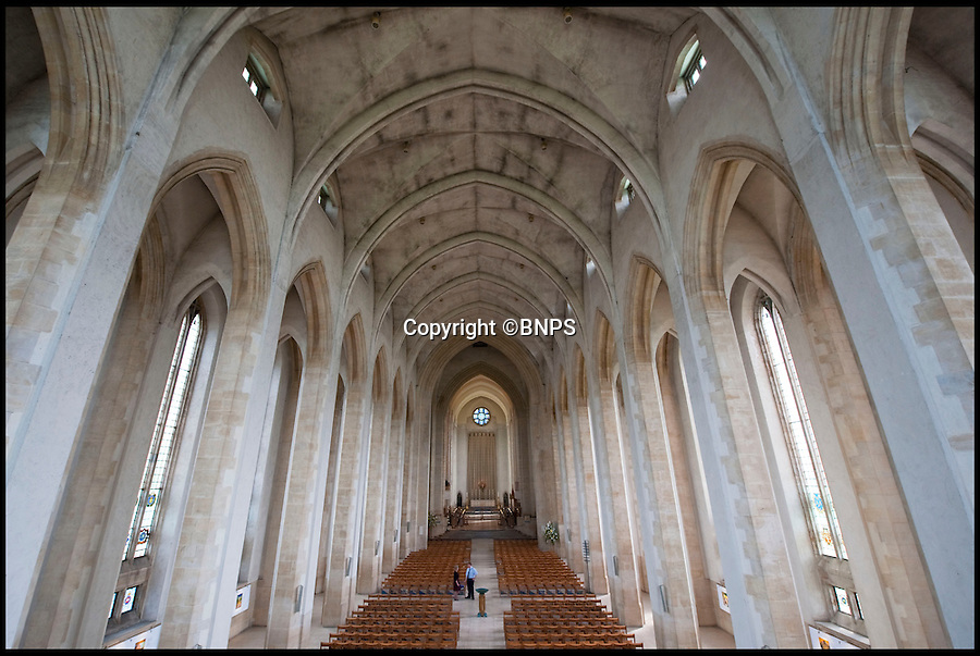 BNPS.co.uk (01202 558833)<br /> Pic: PhilYeomans/BNPS<br /> <br /> The stunning interior of Guildford Catherdal, described by Pevsner as 'noble and subtle'<br /> <br /> Bad omens..<br /> <br /> One of Britains great cathedral's could be closed down if an emergency appeal for £1.3 million is not successful by the end of August.<br /> <br /> Historic Guildford cathedral, where cult horror film The Omen was filmed, is facing closure because its ceiling is laced with asbestos.<br /> <br /> The 10,000sq ft ceiling of Guildford Cathedral was sprayed with a special acoustic plaster made from the deadly mineral in a bid to improve the sound quality when it was built in the 1960s.<br /> <br /> Fifty years on the ceiling has started to crumble forcing church bosses to launch an appeal to raise £7 million pounds to pay for its restoration.<br /> <br /> They say that if the money can't be raised they will have no choice but to close its doors for good - the first British cathedral ever to do so.<br /> <br /> To add further pressure to the campaign, they have to raise 1.3 million pounds by the end of August in order to qualify for a Heritage Lottery Fund.<br /> <br /> More than 200,000 people paid two shillings and sixpence - the equivalent of 12.5 pence today - to buy a brick when the price of building materials shot up after World War II.