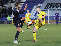 John McGinn gets a foot to the ball before Steven Saunders in the Ross County v St Mirren Scottish Professional Football League match played at the Global Energy Stadium, Dingwall on 17.1.15.