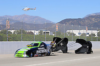 Nov 12, 2010; Pomona, CA, USA; NHRA top alcohol funny car driver Alexis De Joria during qualifying for the Auto Club Finals at Auto Club Raceway at Pomona. Mandatory Credit: Mark J. Rebilas-