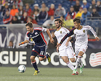 New England Revolution midfielder Kelyn Rowe (11) dribbles as Real Salt Lake defender Carlos Salcedo (16) pressures. In a Major League Soccer (MLS) match, Real Salt Lake (white)defeated the New England Revolution (blue), 2-1, at Gillette Stadium on May 8, 2013.