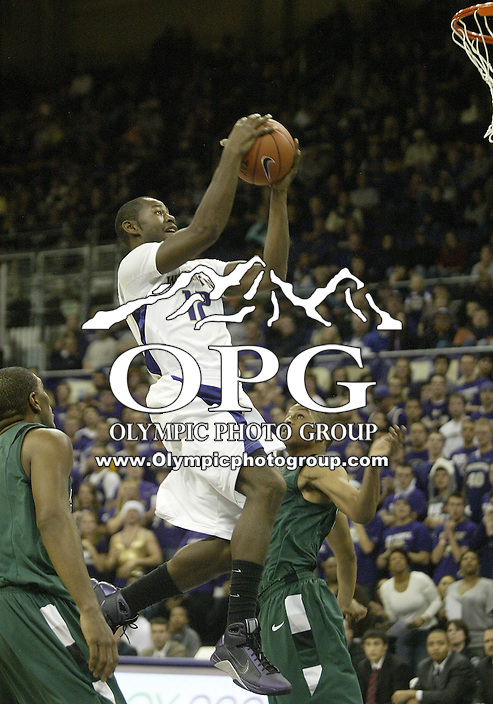 15 November 2009:  Washington Huskies freshman #12 Clarence Trent goes up for a lay up basket against Portland State at the Bank of America Arena at Hec Edmundson Pavilion in Seattle, WA.  Washington won 111-55 over Portland State.