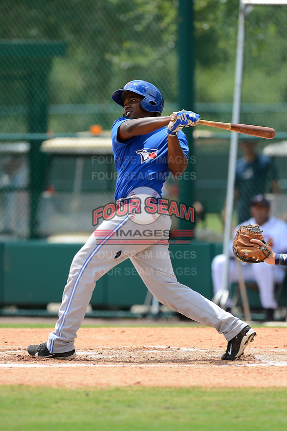 GCL Blue Jays first baseman Gabriel Cenas (15) during a game against the GCL Braves on July 15, 2013 at Disney's Wide World of Sport in Orlando, Florida.  The game was called in the 4th inning due to rain storms with the Braves leading 5-0.  (Mike Janes/Four Seam Images)