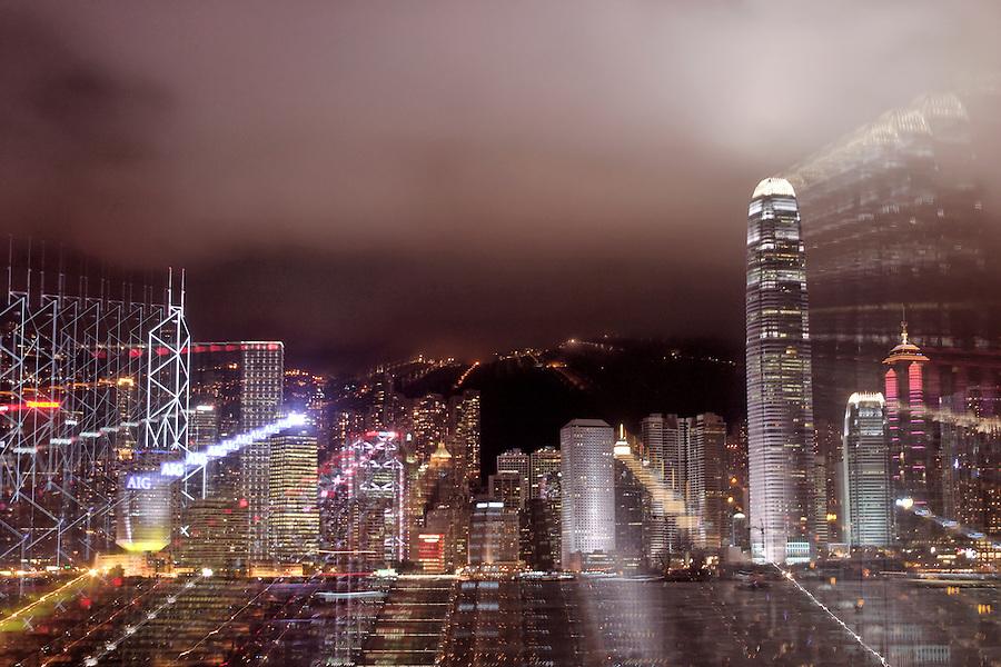 Hong Kong Central above Victoria Harbour viewed from Tsim Sha Tsui Promenade, Kowloon waterfront, Hong Kong SAR, China, Asia