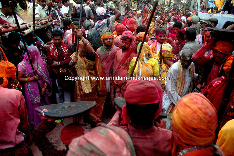 Women bits up men with long sticks. The festival of lathmar holi starts with men taunting women with songs having sexual connotation agasinst which the ladies hit them hard with long sticks. the man uses padding to stop getting hurt  . As holi itself is played among men and women but only in Barsana holi is still celebrated in the way its written in the epics. Barsana, Uttarpradesh, India