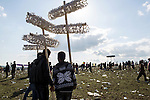 By 4 p.m., Newroz, the Kurdish New Year celebration, is over, and the crowd thins out, leaving the flower-crown hawkers and trash on the ground, in Suruç, Turkey, March 17, 2015. Newroz, or Nowruz, is an ancient holiday celebrated by a multitude of ethnic groups across Iran, Central Asia, and the Caucuses, and ushers in the first day of Spring, March 21. For Kurds, Newroz is a means of political and cultural expression, featuring Kurdish politicians, activists, and musicians, and has become a manifestation of Kurdish identity. In Turkey, the celebrations begin a few days before the Vernal Equinox, culminating in a huge gathering in the heart of Turkey's Kurdish population, the southeastern city of Diyarbakir. This year, PKK founder Abdullah Öcalan, who despite serving a life sentence for treason still enjoys widespread influence among Kurds, sent a letter that was read at Newroz in Diyarbakir, calling for an end to the PKK's armed struggle against the Turkish state.
