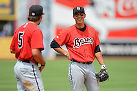 Birmingham Barons shortstop Tyler Saladino #23 talks with Daniel Wagner #5 during a game against the Chattanooga Lookouts on April 17, 2013 at AT&T Field in Chattanooga, Tennessee.  Chattanooga defeated Birmingham 5-4.  (Mike Janes/Four Seam Images)
