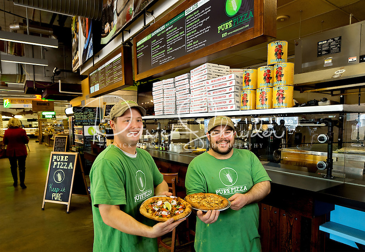 Pure Pizza is a vendor at 7th Street Public Market in Uptown Charlotte, North Carolina. Building upon the success of Charlotte's Center City Green Market, the Seventh Street Public Market opened in 2012 to be a year-round market serving and celebrating local food artisans, entrepreneurs and local and regional farmers. Image is part of a series of photos taken of the Center City attraction.