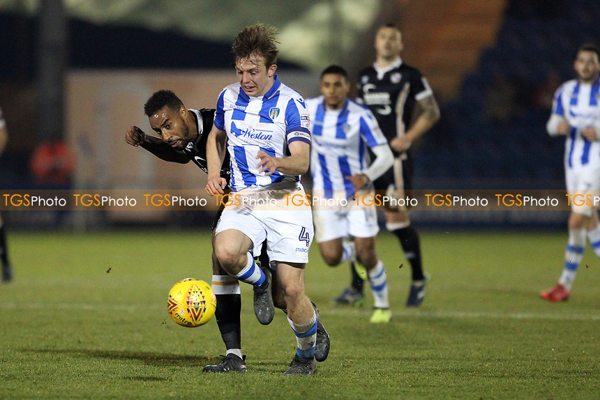 Tom Lapslie of Colchester United runs with the ball when under pressure from Tyrone Barnett of Port Vale during Colchester United vs Port Vale, Sky Bet EFL League 2 Football at the Weston Homes Community Stadium on 23rd December 2017