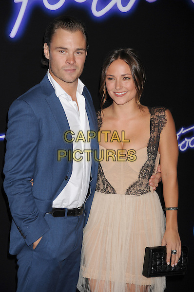 "Patrick John Flueger, Briana Evigan.""Footloose"" Los Angeles Premiere held at the Regency Village Theatre, Westwood, California, USA..October 3rd, 2011.half length dress black lace nude cream beige sheer dress sleeveless cleavage  white shirt blue suit clutch bag.CAP/ROT/TM.©Tony Michaels/Roth Stock/Capital Pictures"