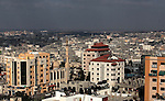 A general view shows Gaza City on July 07, 2014. Israeli air strikes on Gaza, that killed at least seven Palestinian militants overnight, came after a day in which armed groups fired at least 25 rockets and mortar rounds at southern Israel. The Gaza violence came as violence raged across annexed east Jerusalem and Arab towns in Israel following the kidnap and murder of a Palestinian teenager in a suspected revenge attack by Jewish extremists who burned him alive. Photo by Ashraf Amra