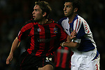 Blackburn Rovers 3, Huddersfield Town 1, 22/09/2005. Ewood Park, Carling Cup.  Rovers' Georgian internationalist Zurab Khizanishvili, scorer of his side's second goal (his first for the club) gets to grips with Town's John McCombe. Photo by Colin McPherson.