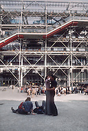 Paris, August 1977. Centre Pompidou. August in Paris is a noveable feast. While millions of residents are leaving for their favourite resorts, thousands of foreign tourists are flocking to the French Capital. Nevertheless, genuine Parisians, old and young alike, stay in Paris and mantain the tradition charm.