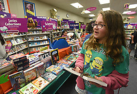 NWA Democrat-Gazette/FLIP PUTTHOFF <br /> BOOK FAIR FUNDRAISER<br /> Mayra Cargill (cq), a fifth-grade student at Bonnie Grimes Elementary in Rogers, shops Wednesday Feb. 6 2019 at the school's book fair. Students select from an array of books and posters and purchase them as a fundraiser for the school library, said Linda Jefferson, librarian at Grimes. The book fair continues through Friday. Several schools in the Rogers district hold book fairs in February, Jefferson added.