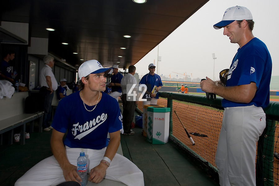 20 August 2007: Florian Peyrichou (left) talks to Gaspard Fessy in the dugout prior to the Czech Republic 6-1 victory over France in the Good Luck Beijing International baseball tournament (olympic test event) at the Wukesong Baseball Field in Beijing, China.