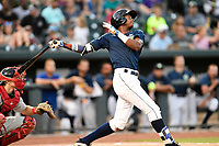 Shortstop Hansel Moreno (12) of the Columbia Fireflies bats in a game against the Greenville Drive on Saturday, May 26, 2018, at Spirit Communications Park in Columbia, South Carolina. Columbia won, 9-2. (Tom Priddy/Four Seam Images)