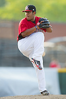Relief pitcher Joseph Ortiz #31 of the Hickory Crawdads in action against the Greensboro Grasshoppers at  L.P. Frans Stadium July 10, 2010, in Hickory, North Carolina.  Photo by Brian Westerholt / Four Seam Images