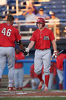 Williamsport Crosscutters Henri Lartigue (40) congratulates Darick Hall (46) crossing home plate after hitting a home run during a game against the Batavia Muckdogs on September 2, 2016 at Dwyer Stadium in Batavia, New York.  Williamsport defeated Batavia 9-1. (Mike Janes/Four Seam Images)