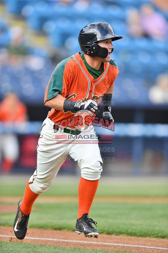 Greensboro Grasshoppers left fielder Aaron Knapp (7) runs to first base during a game against the Asheville Tourists at McCormick Field on April 27, 2017 in Asheville, North Carolina. The Tourists defeated the Grasshoppers 8-5. (Tony Farlow/Four Seam Images)