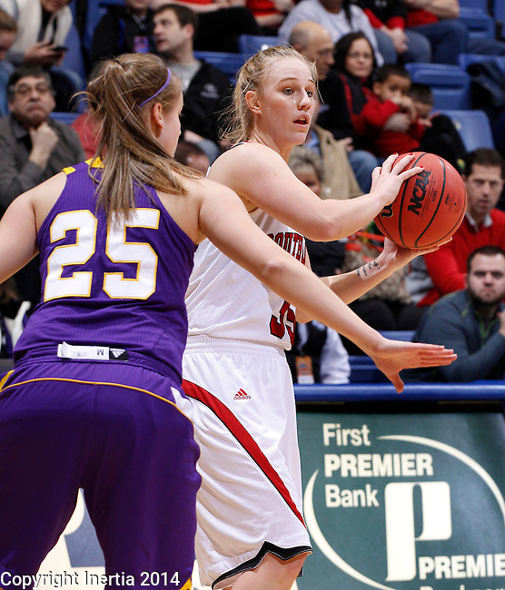 SIOUX FALLS, SD - MARCH 9:  Nicole Seekamp #35 of USD looks past Western Illinois defender Liz Skotowski #25 during their quarterfinal game at the 2014 Summit League Basketball Championships at the Sioux Falls Arena Sunday. (Photo by Dick Carlson/Inertia)