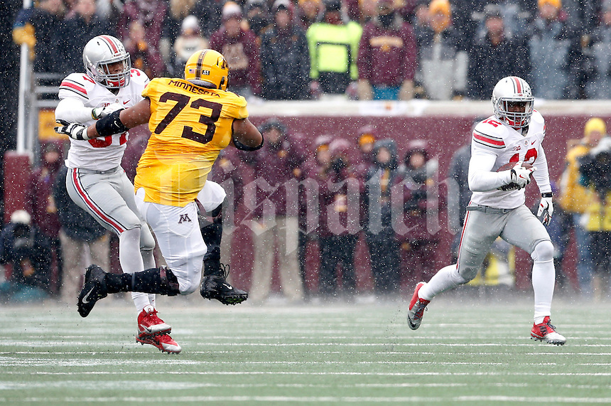 Ohio State Buckeyes cornerback Doran Grant (12) returns an interception against Minnesota Golden Gophers during the 3rd quarter at TCF Bank Stadium in Minneapolis, Minn. on November 15, 2014.  (Dispatch photo by Kyle Robertson)