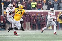 Ohio State Buckeyes cornerback Doran Grant (12) returns an interception against Minnesota Golden Gophers during the 3rd quarter at TCF Bank Stadium in Minneapolis, Minn. on November 15, 2014.  (Dispatch photo by Kyle Robertson)