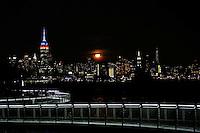 HOBOKEN, NJ - OCTOBER 16: A full Hunter's super moon rises behind middle Manhattan and Empire State Building in New York City on October 16, 2016 as seen from Hoboken, NJ, VIEWpress/Eduardo Munoz Alvarez